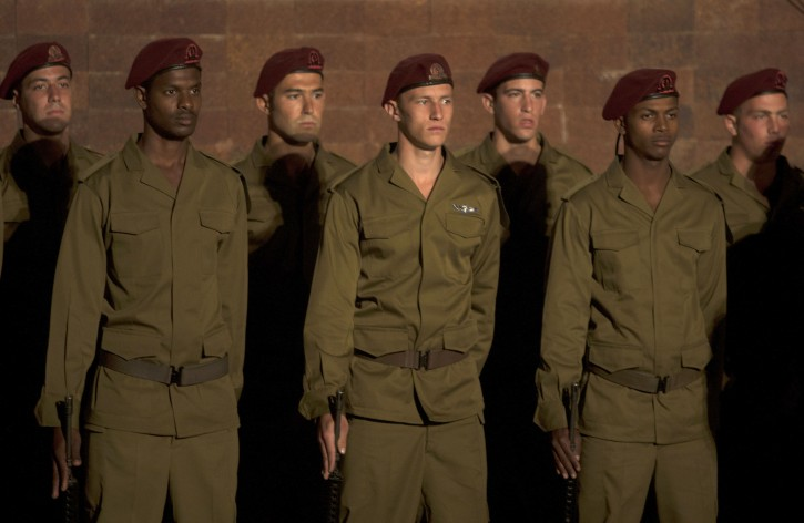 Israeli soldiers solemnly stand during the opening ceremony of Holocaust Remembrance Day at Yad Vashem Holocaust Memorial in Jerusalem, Sunday, May 1, 2011. Israel is marking its annual remembrance day for the six million Jews killed by the Nazis in World War II. (AP Photo/Sebastian Scheiner)