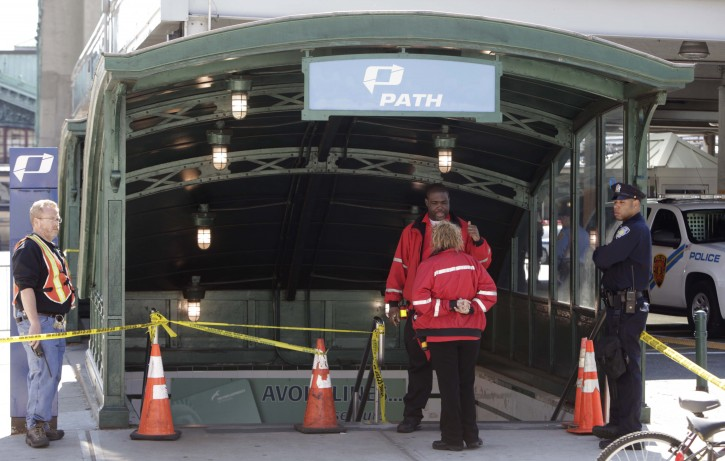 Emergency personnel gather near the entrance to the PATH station in Hoboken, Sunday, May 8, 2011. A spokesman says a train pulling into the station struck an abutment, causing minor injuries. (AP Photo/Seth Wenig)
