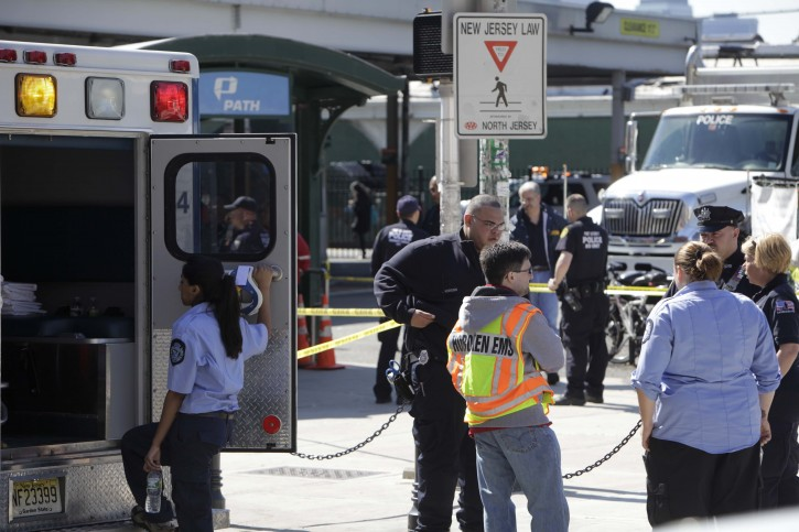 Emergency personnel gather near the entrance to the PATH station in Hoboken, Sunday, May 8, 2011. A spokesman says a train pulling into the Hoboken, N.J., station struck an abutment, causing minor injuries. (AP Photo/Seth Wenig)