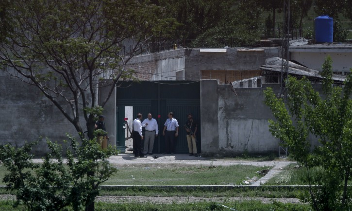 Pakistani security officials leave after the examining a house where al-Qaida leader Osama bin Laden was caught and killed in Abbottabad, Pakistan on Wednesday, May 4, 2011. The residents of Abbottabad, Pakistan, were still confused and suspicious on Wednesday about the killing of Osama bin Laden, which took place in their midst before dawn on Monday. (AP Photo/Anjum Naveed)