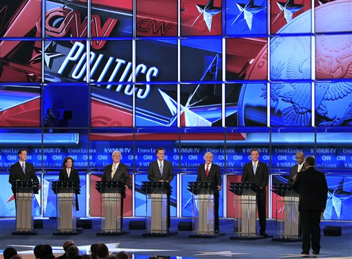 From left, former Pennsylvania Sen. Rick Santorum, Rep. Michele Bachmann, R-Minn., former House Speaker Newt Gingrich, former Massachusetts Gov. Mitt Romney, Rep. Ron Paul, R-Texas, former Minnesota Gov. Tim Pawlenty and businessman Herman Cain are seen on stage during the first New Hampshire Republican presidential debate at St. Anselm College in Manchester, N.H., Monday, June 13, 2011. (AP Photo/Jim Cole)