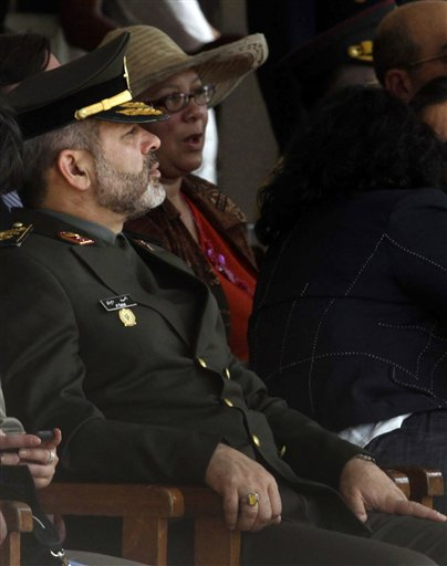 Iran's Defense Minister Gen. Ahmad Vahidi, left, looks on during a military ceremony in Santa Cruz, Bolivia, Tuesday, May 31, 2011. Vahidi, whose extradition is sought by neighboring Argentina for the 1994 bombing of a Jewish center, briefly visited Bolivia on Tuesday, raising tensions between the countries. (AP Photo)