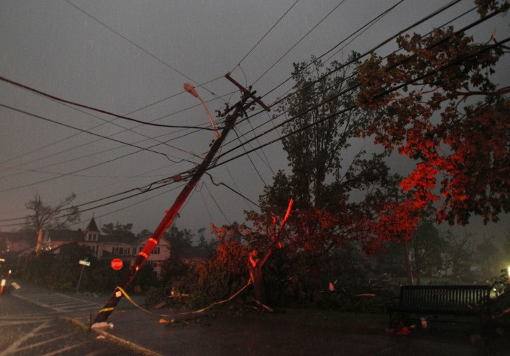 Power lines, lit up by emergency vehicle lights, are downed after a tornado swept through Monson, Mass. Wednesday, June 1, 2011. (AP Photo/Elise Amendola)