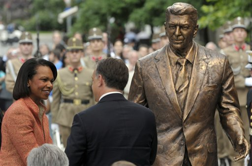 Former U.S. Secretary of State Condoleezza Rice, left, and Hungarian Prime Minister Viktor Orban, center, greet each other after unveiling the new statue of late US President Ronald Reagan, during a centennial commemoration in Budapest, Hungary, Wednesday, June 29, 2011. The 180 kilograms (400 pounds) and 2.18 meter (7 feet, 2 inches) tall bronze statue honors Reagan at the Freedom Square in central Budapest to mark his efforts to free the people of Hungary from the yoke of communism. (AP Photo/Bela Szandelszky)