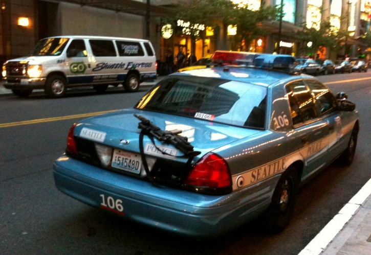 This handout photo captured by Nick Gonzalez shows a police rifle left unattended on a patrol car outside a busy downtown area on Tuesday, June 28, 2011, in Seattle. A Seattle police spokesman says the department has launched an investigation into the incident.  Rifles are assigned only to officers who have additional training and are usually kept in the trunk or between the driver and passenger seats. (AP Photo/Nick Gonzalez)