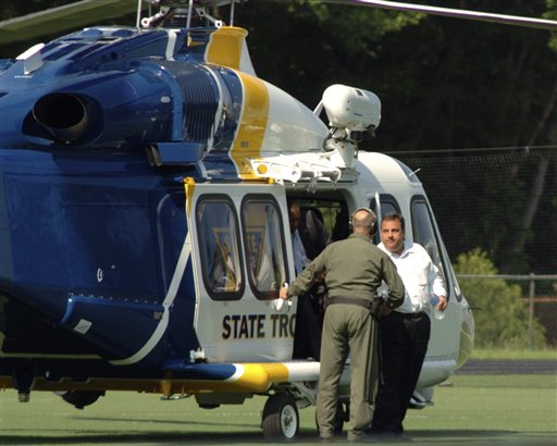 In this In this May 31, 2011 photo, New Jersey Gov. Chris Christie, right, exits a state helicopter to attend his son's high school baseball game in Montvale, N.J. State police say it costs $2,500 an hour to fly a state helicopter, but that flying Christie to his son's high school baseball game didn't cost taxpayers anything extra. (AP Photo/PATCH.com, Christopher Costa)