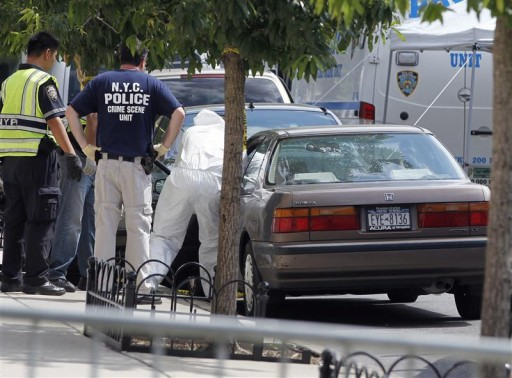 NYPD crime scene investigators inspect the car of the suspected killer of Leiby Kletzky ,8, outside his home in the Orthodox Jewish section of Borough Park in the Brooklyn borough of New York July 13, 2011.  Reuters