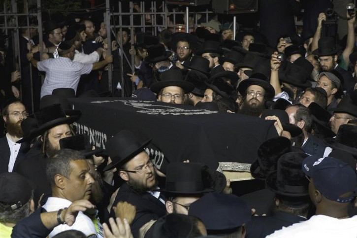 The casket of Leibby Kletzky is carried out of a synagogue after his funeral service in New York July 13, 2011. A Brooklyn man was under arrest on Wednesday after the dismembered remains of Kletzky, who had gotten lost two days earlier walking home from camp, were found in the man's freezer and a trash container, police said. Kletzky, 8, was supposed to meet his family on Monday on his walk home from day camp in Brooklyn's Borough Park neighborhood but never arrived, police said.  REUTERS/Lucas Jackson