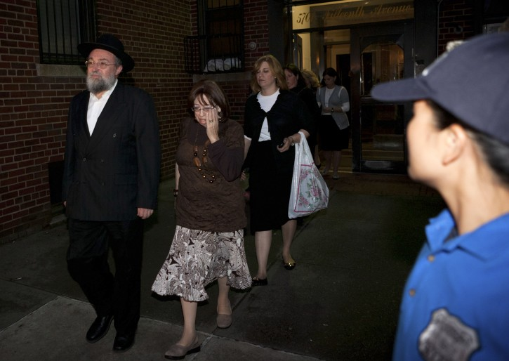 Family of 8-year-old Leiby Kletzky leave for funeral services in the Brooklyn borough of New York Wednesday, July 13, 2011. The boy, who got lost while walking home alone from day camp in his Orthodox Jewish Brooklyn neighborhood, was killed and dismembered by a stranger he had asked for directions, and his remains were found stuffed in a trash bin and the man's refrigerator, police said Wednesday. (AP Photo/John Minchillo)