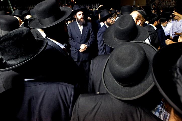 Community members and others wait before the start of a funeral service for Leiby Kletzky, 8, Wednesday, July 13, 2011 in the Brooklyn borough of New York. The Brooklyn boy, who got lost while walking home alone from day camp in his Orthodox Jewish neighborhood, was killed and dismembered by a stranger he had asked for directions, and his remains were found stuffed in a trash bin and the man's refrigerator, police said Wednesday. (AP Photo/Craig Ruttle)