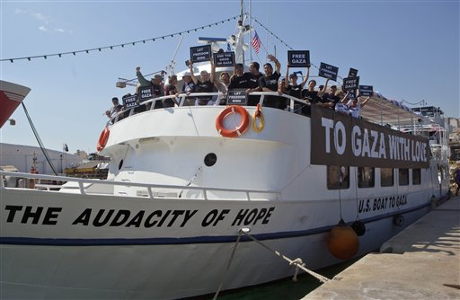 "Activists from the U.S. stand on their boat named ""The Audacity of Hope"" moored in Perama, near Athens, Greece, Thursday, June 30, 2011.AP"