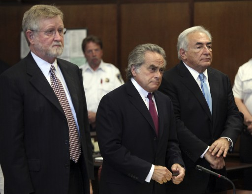 Former International Monetary Fund leader Dominique Strauss-Kahn, right, is represented by his attorneys Benjamin Brafman, center, and William Taylor in New York State Supreme Court Friday, July 1, 2011 in New York. A judge has agreed to free Strauss-Kahn without bail or home confinement in the assault case against him. The criminal case against him stands. (AP Photo/Todd Heisler, Pool)