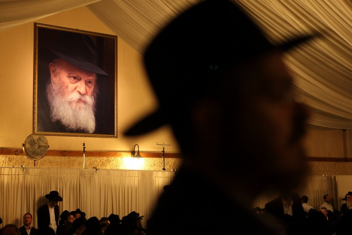 Lubavitcher chasidim gather in K'far Chabad yesterday, July 4 2011 to speak about the Rabbi's passing and his legacy. Photo by Yaakov Nahumi/Flash90.