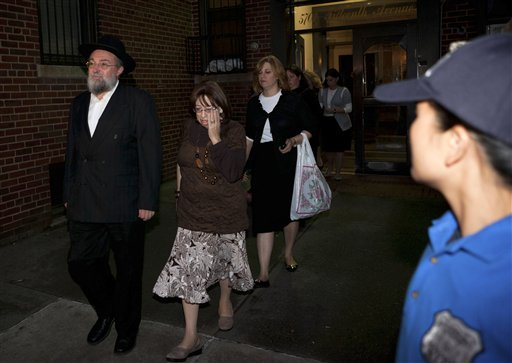 Family of 8-year-old Leiby Kletzky leave for funeral services in the Brooklyn borough of New York Wednesday, July 13, 2011. AP