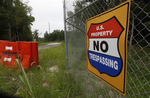 A sign issues a warning to trespassers at the perimeter of the Naval Air Station Oceana Dam Neck Annex, Saturday, Aug. 6, 2011, in Virginia Beach , Va.  The base is the headquarters for Seal Team Six whose team members were involved in a helicopter crash in Afghanistan.  (AP Photo/Steve Helber)