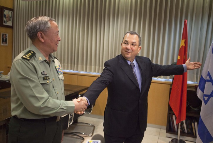 Gen. Chen Bingde chief of the General Staff of the Chinese People's Liberation Army, left, shakes hands with Israeli Defense Minister Ehud Barak during their meeting in Tel Aviv, Sunday, Aug. 14, 2011. After years of rocky relations, Israel welcomed hosting China's military chief Sunday for the first such visit, giving an opportunity for Israel to increase its profile with the economic giant as China seeks to strengthen its foothold in the Middle East. (AP Photo/Dan Balilty)