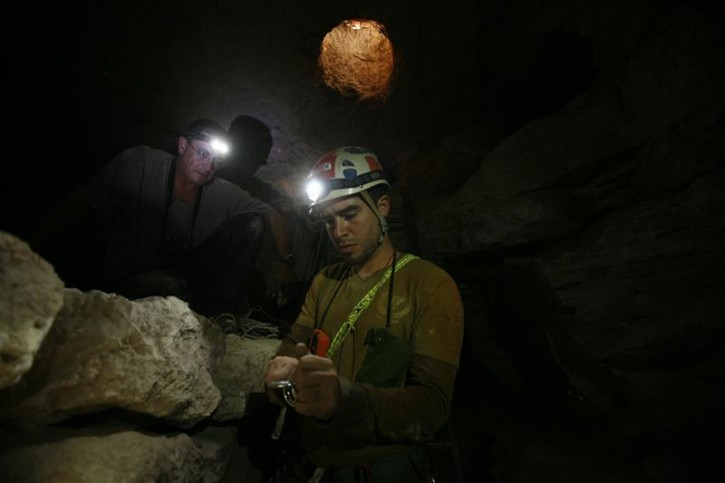 Researchers Boaz Langford (R) and Boaz Zissu are seen inside an ancient rebel hideout at Hurvat Burgin archaeological site, at the foothills of Jerusalem around the ancient city of Beit Guvrin August 30, 2011. You'll need a headlamp, a tight waistline and no fear of the dark in order to enjoy one of the most extreme, yet lesser known, archaeological wonders of the Holy Land - Ancient tunnel systems dug by Jewish rebels to fight the Roman empire. To match Reuters Life! ISRAEL-CAVES/  REUTERS/Baz Ratner