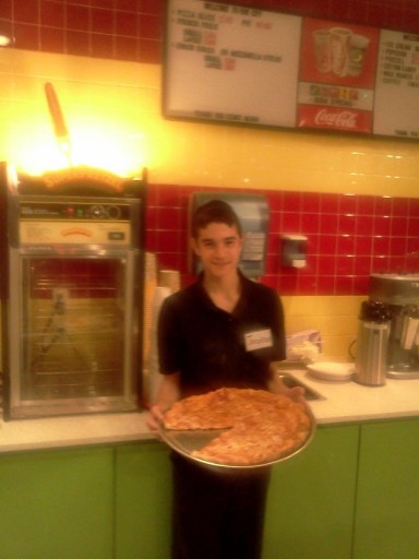 New Hempstead resident Nosson Reiser, serving  pizza at Fun City's kosher l'mehadrin snack bar in the Palisades Mall.