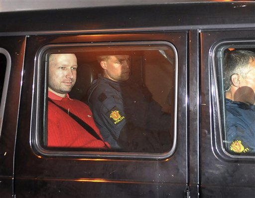 FILE - In this July 25, 2011 file photo, Norway's twin terror attacks suspect Anders Behring Breivik, left, sits in an armored police vehicle after leaving the courthouse following a hearing in Oslo, Norway  AP