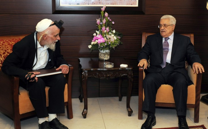 A photograph supplied by the Palestinian Authority shows Palestinian President Mahmoud Abbas (R) in a meeting with Israeli Rabbi Menachen Furman, an Israeli peacemaker who lives in a Jewish settlement in the West Bank, in his Ramallah, West Bank offices on 31 August 2011. Furman was a founding member of the Gush Emunim movement, but has since forged ties with Palestinians, including the Islamic Hamas movement in order to promote interfaith dialogue.  EPA/MUFEED ABU HASNAH / PALESTINIAN AUTHORITY / HANDOUT