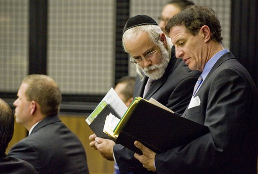 Attorneys Micheal Schwartz, center, and William Hadden, right, confer during the arraignment hearing for their client Fullerton police officer Jay Cicinelli, left, in  Orange County Superior Court on Wednesday, Sept. 21, 2011  in Santa Ana, Calif.    Prosecutors charged one police officer with murder and another with manslaughter  in the killing of  37-year-old Kelly Thomas,  an unarmed, mentally ill homeless man who was pummeled, shocked with a Taser and slammed with the butt of a stun gun in a beating that lasted nearly 10 minutes.  Manuel Ramos was charged with one count each of second-degree murder and involuntary manslaughter .   Cicinelli was charged with one count each of involuntary manslaughter and excessive force. (AP Photo/Paul Rodriguez)