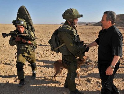In this file photo provided by the Israeli Defense Ministry on 19 August 2011 shows Defense Minister Ehud Barak (R) as he meets with soldiers along the Egyptian border after 'terror' attacks earlier against army and civilians in the area north of the resort town of Eila