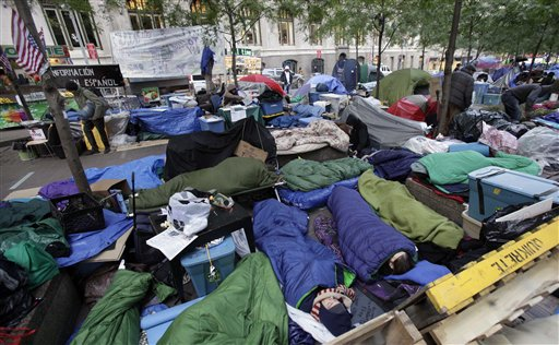FILE - In this Oct. 24, 2011 file photo, people sleep in New York's Zuccotti Park, home to Occupy Wall Street protesters. With thousands of people roughing it in parks for up to six weeks related to the Occupy Wall Street demonstrations, public health is a growing worry in the encampments. (AP Photo/Richard Drew, File)
