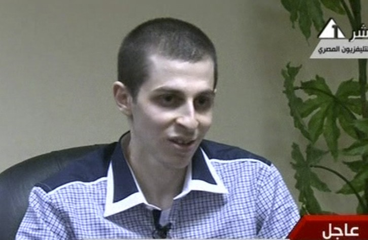 In this image from Egypt TV Tuesday Oct 18 2011 Israeli soldier Gilad Schalit is seen at an undisclosed location, during a pre-recorded interview released Tuesday.  Schalit was moved in to Egypt from captivity in Gaza beginning an elaborate prisoner swap deal in which hundreds of Palestinian inmates are to be freed in return for the captured tank crewman. (AP Photo/ Egypt TV)