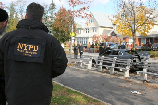 NYPD hate crime investigators at the apparent bias attack in Brooklyn, on Nov 11 2011, in which cars were burned and anti-Semitic messages were scrawled in the predominantly Jewish neighborhood.  Photo: Shimon Gifter