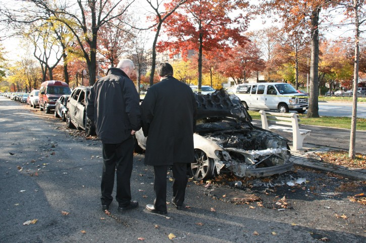 NYPD hate crime investigators at the apparent bias attack in Brooklyn, in which cars were burned and anti-Semitic messages were scrawled in the predominantly Jewish neighborhood.  Photo: Shimon Gifter