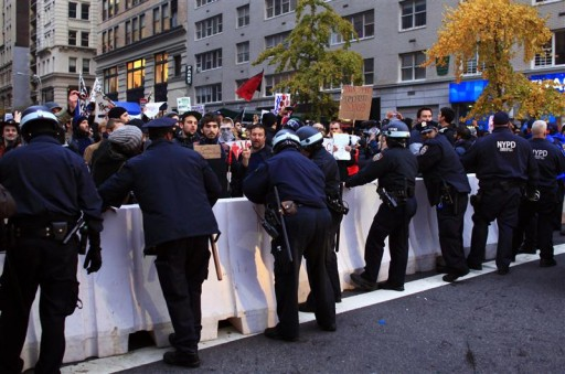 N.Y. City police officers barricade out protesters affiliated with the Occupy Wall Street movement in Manhattan November 17, 2011. New York police prevented protesters from shutting down Wall Street on Thursday, arresting at least 177 people in repeated clashes with an Occupy Wall Street rally that drew fewer demonstrators than expected.  REUTERS/Eduardo Munoz