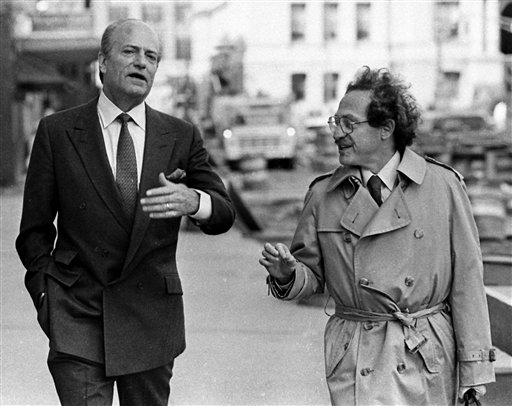 FILE - In this April 29, 1985 file photo, Claus von Bulow, left, walks toward Providence Superior Court with his defense attorney Alan Dershowitz,  to hear testimony in von Bulow's trial in Providence, R.I., where the socialite faced charges of trying to kill his American heiress wife. The papers of the prominent lawyer and author are now available to researchers at Dershowitz's alma mater, Brooklyn College. Dershowitz donated his papers to Brooklyn College rather than Harvard, where he is a professor.  (AP Photo/Charles Krupa, File)