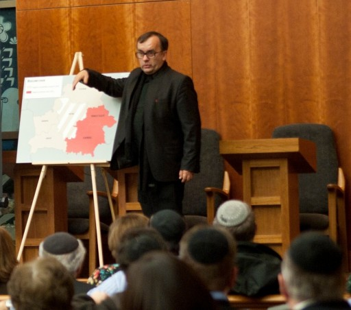 Father Patrick Desbois, president of Yahad-In Unum, talks about his work of identifying and locating undiscovered mass graves of Jews killed during the Holocaust in Eastern Europe at Young Israel of Woodmere.  Photo by Isabel Slepoy /  LI Herald
