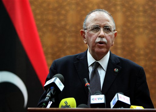 In this Monday, Oct. 31, 2011 photo, Libya's new U.S. educated electrical engineer prime minister Abdurrahim el-Keib speaks in Tripoli, Libya. El-Keib, an NTC member from Tripoli with a doctorate from North Carolina State University, said he would appoint the government within two weeks. (AP Photo)