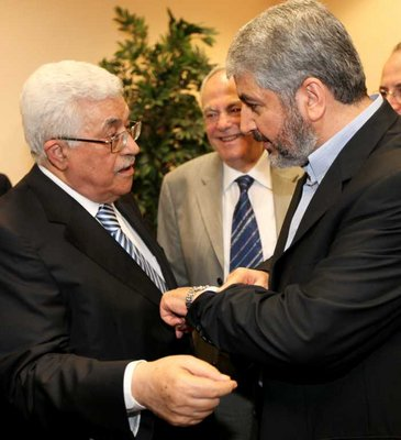 FILE - Handout picture released by the Hamas Press Office shows Palestinian president Mahmud Abbas (L) speaking with Hamas leader Khaled Meshaal (R) in Cairo, Egypt, 04 May 2011