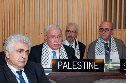A handout photo issued by UNESCO shows Foreign Minister of the Palestinian Authority, Riyad Al-Malki (2-L) and other delegates attending the session of the UNESCO General Conference in which Palestine is voted as a new UNESCO member State in Paris, France, 31 October 2011. Palestine's entry will bring the number of UNESCO's member states to 195. The inclusion of Palestine  was carried out with 107 votes in favor of admission and 14 votes against, with 52 abstentions.  EPA/