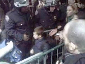 A small boy is seen trying to get through the chaos to his school on Wall Street on Nov. 17, 2011. (Photo: CBS 2)