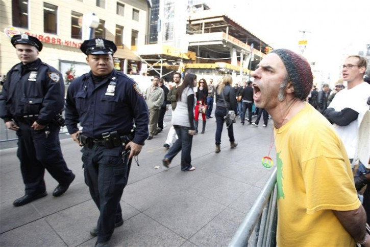 """A protester yells out at passers-by at the """"Occupy Wall Street"""" encampment in Zuccotti Park in New York November 14, 2011. REUTERS/Brendan McDermid"""
