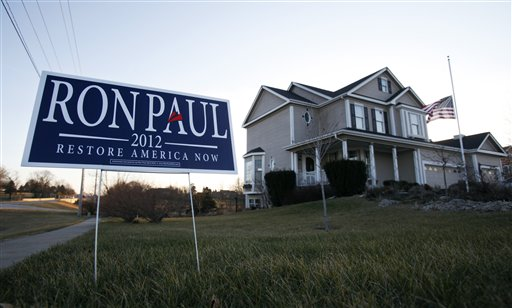 A campaign sign for Republican presidential candidate U.S. Rep. Ron Paul, R-Texas, sits in front of home, Tuesday, Dec. 27, 2011, in Ankeny, Iowa. (AP Photo/Charlie Neibergall)