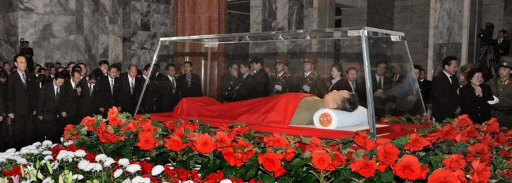 The body of North Korean leader Kim Jong Il is laid in a memorial palace in Pyongyang, North Korea, Tuesday, Dec. 20, 2011. (AP Photo/Kyodo News)