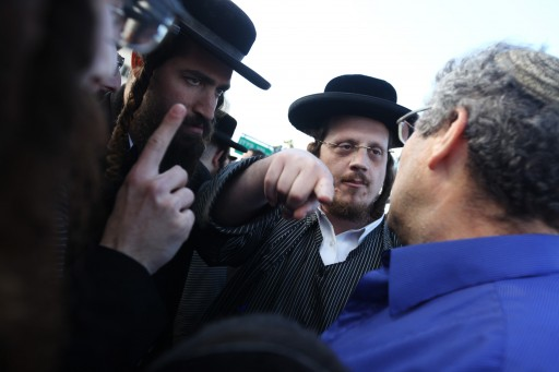 Ultra orthodox jewish men argue with a modern orthodox religious men in the city of Beit Shemesh. Photo by Kobi Gideon / Flash90.