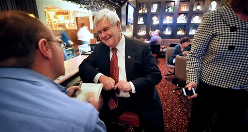 Republican presidential candidate former House Speaker Newt Gingrich gives an interview Wednesday Nov. 30, 2011, during a campaign stop in Council Bluffs, Iowa.(AP Photo/Dave Weaver)