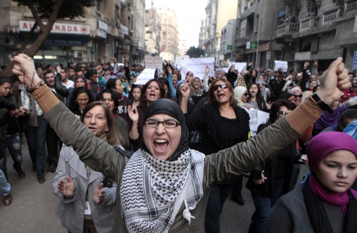 Hundreds of Egyptian women march at Cairo streets during a protest as they angered by the recent violence used against them in clashes between police and protesters in Cairo, Egypt Tuesday, Dec. 20, 2011. Egypt's ruling generals are coming under mounting criticism at home and abroad for the military's use of excessive force against unarmed protesters, including women, as they try to crush the pro-democracy movement calling for their ouster. (AP Photo/Amr Nabil)