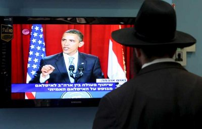 FILE -  An ultra-Orthodox Jewish man pauses to watch the speech by US President Baracjk Obama delievered in Cairo on 04 June 2009. EPA