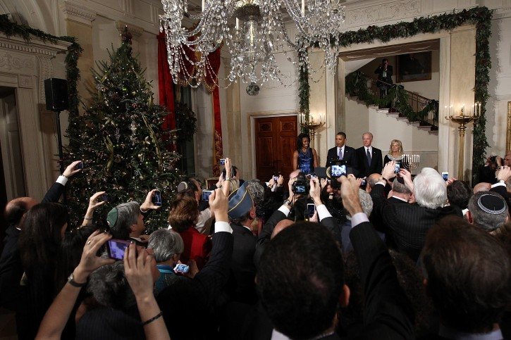 (L-R) US first lady Michelle Obama, U.S. President Barack Obama, Dr. Jill Biden, and US Vice President Joe Biden deliver remarks at the White House during a Hanukkah reception, in Washington, DC, USA, 08 December 2011. The reception helped recognize and celebrate the Jewish tradition also known as the Festival of Lights.  EPA/Win McNamee / POOL AFP OUT