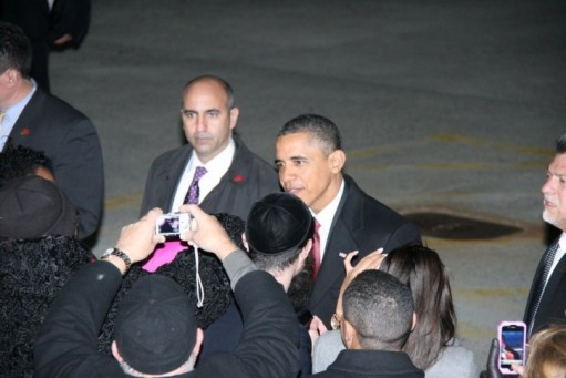 President Barack Obama greets well wishers as he arrives at John F. Kennedy International Airport in New York, Wednesday, Nov. 30, 2011, on his way to attend fundraisers in New York City. Photo: Shimon Gifter