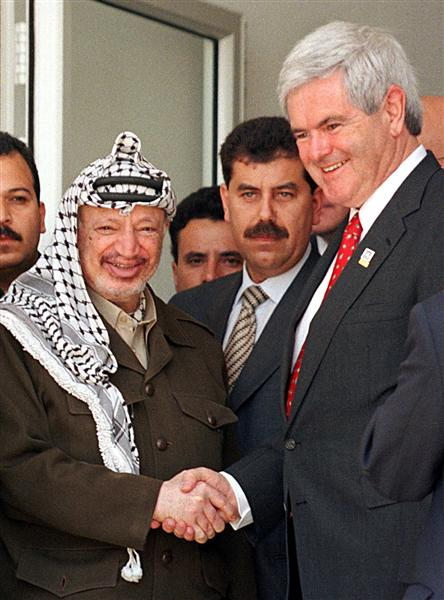 U.S. House Speaker Newt Gingrich (R) shakes hands with Palestinian President Yasser Arafat following their meeting in Ramallah May 27 1998.