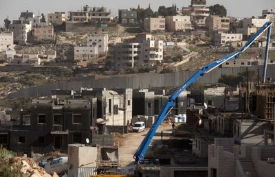 Construction work underway in a new neighborhood in the sprawling East Jerusalem neighborhood of Pizgat Zeev, which many consider a Jewish settlement, north of Jerusalem, 08 January 2012.  EPA