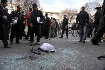 Iranian policemen and people stand around a blast site in Tehran, Iran, 11 January 2012.