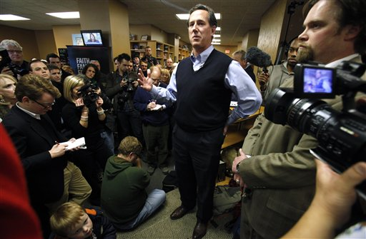 Republican presidential candidate former Pennsylvania Senator Rick Santorum speaks to local residents during a campaign stop at the Daily Grind coffee shop, Sunday, Jan. 1, 2012, in Sioux City, Iowa. Republican presidential candidates are largely shifting from persuading voters to mobilizing them for Tuesday's caucuses. (AP Photo/Charlie Neibergall)